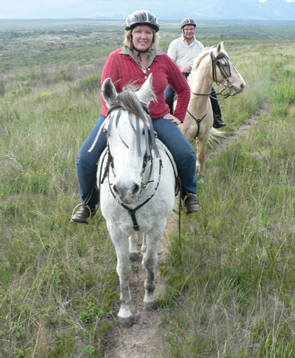 Safari Club Holidays & Tours - Ellie & Paul on horse-back safari